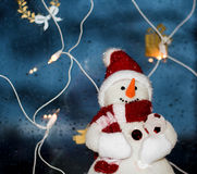 The snowman. A christmas ornament of a snowman with christmas lights hanging from the window Stock Photography