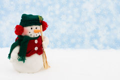 Snowman. On snow with snowflake background Stock Image