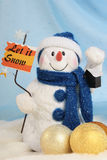 Snowman. With tablet let it snow Stock Photo