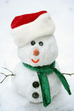 Snowman 7. Snowman smiling fase with red hat tied Stock Photos