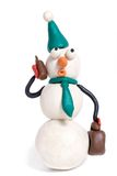 Snowman. Anxiously talks by mobile phone royalty free stock photo