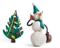 Snowman. Anxiously talks by mobile phone royalty free stock image