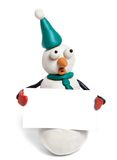 Snowman. Holds in hands balnk card stock photo
