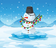 A snowman above an iceberg with a pail above its head Royalty Free Stock Image