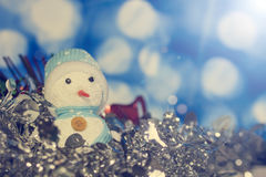 Snowman on abstract background Stock Images