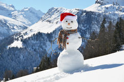 Snowman against Alpine panorama Royalty Free Stock Photo