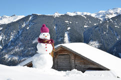 Snowman against Alpine panorama Royalty Free Stock Image