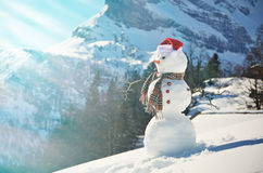 Snowman against Alpine panorama Royalty Free Stock Photography