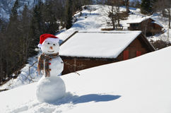 Snowman against Alpine panorama Stock Photography