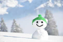 Snowman against Alpine scenery Stock Photos