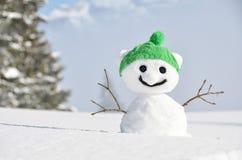Snowman against Alpine scenery Stock Image