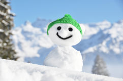 Snowman against Alpine scenery Royalty Free Stock Images