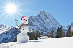 Snowman against Alps Stock Images