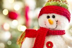Snowman. Against defocused christmas lights Stock Image