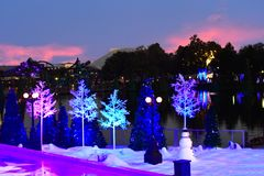 Free Snowman And Holiday Trees On Colorful Sunset Background In International Drive Area. Stock Photo - 132245750