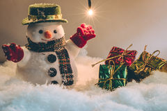 Free Snowman And Light Bulb Stand Among Pile Of Snow At Silent Night, Merry Christmas And Happy New Year Night. Royalty Free Stock Photo - 63512735