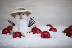 The snowman announces the arrival of the winter holidays. The charm of the winter holidays royalty free stock image