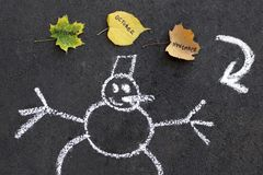 Snowman and autumn leaves seasons change royalty free stock photos