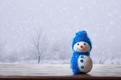 Snowman. On the background of falling snow Stock Image