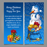 Snowman with bag of gifts Royalty Free Stock Photo