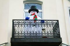 Snowman on the balcony. Snowman congratulates happy new year Royalty Free Stock Photo