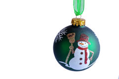 Snowman bauble. Green Christmas bauble with snowman design hanging on Green organza ribbon, white background, cut-out Royalty Free Stock Photography