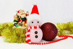 Snowman, bauble and Santa Claus toy. On the white background Royalty Free Stock Photography