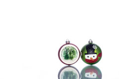 Snowman Baubles with snowglobe with christmas tree inside Stock Photo