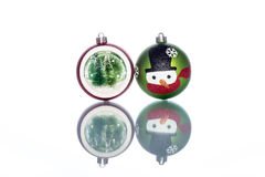 Snowman Baubles with snowglobe with christmas tree inside Stock Photos