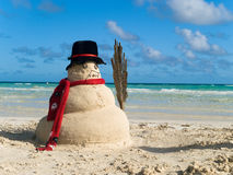 Snowman on beach. Snowman made of sand on idyllic tropical beach Royalty Free Stock Photos