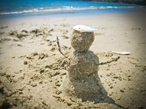 Snowman on a beach royalty free stock photography
