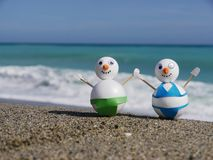 Snowman beach vacation Royalty Free Stock Photos