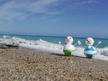 Snowman beach vacation Royalty Free Stock Photo