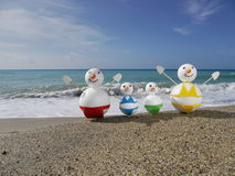 Snowman beach vacation Stock Images