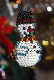 Snowman from beads. Decorating a Christmas tree for the new year Royalty Free Stock Photo