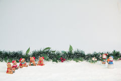 Snowman and Bears with Mistletoe in Snow Royalty Free Stock Photography
