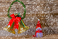Snowman and bells. On Christmas and new years Day Royalty Free Stock Photo