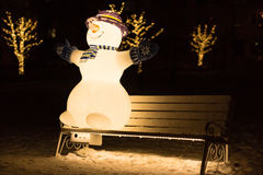 Snowman on the bench. Winter 2013-2014. January 23, 2014. Russia. Moscow. Bibirevo. Christmas decorations of the city park. Highlighted Snowman on a Park bench Stock Images