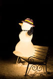 Snowman on the bench. Winter 2013-2014. January 23, 2014. Russia. Moscow. Bibirevo. Christmas decorations of the city park. Highlighted Snowman on a Park bench Stock Image