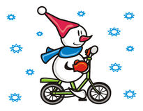 Snowman on a bicycle Royalty Free Stock Photos