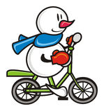 Snowman on a bicycle Stock Photo