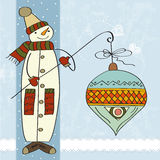 Snowman with big Christmas ball Royalty Free Stock Photos