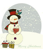 Snowman and the bird Royalty Free Stock Images
