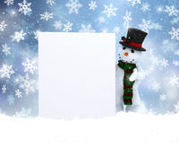 Snowman with blank sign. Christmas background with a snowman holding a blank sign Stock Photography