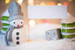 Snowman with blank sign Stock Image