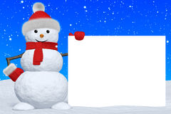 Snowman with blank white board under snowfall Stock Photo