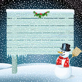 Snowman and blank wooden sign Stock Image