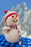 Snowman on blocks toy. Snowman with mountains in the background Stock Image