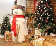 A snowman in a blue hat stock images