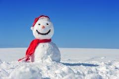 Snowman. On blue sky background Stock Photography